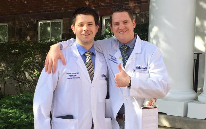 Peter Boor, MD and Nick Ferguson, MD, Class of 2017 celebrate the end of their training on a sunny, spring day.